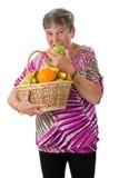 Mulher superior que morde em uma maçã Fotos de Stock Royalty Free