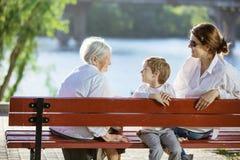 Mulher superior, seus neta adulta e grande - neto no parque Foto de Stock Royalty Free