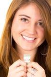 Mulher supersticioso bonita que guarda um dólar Fotografia de Stock Royalty Free