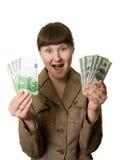 Mulher surpreendida com euro e dólares Imagens de Stock Royalty Free