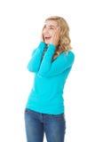 Mulher surpreendida com mãos na cabeça Imagem de Stock Royalty Free