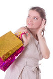 Mulher surpreendida com sacos de compras Imagens de Stock Royalty Free