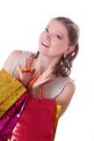 Mulher surpreendida com sacos de compras Fotos de Stock Royalty Free