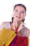Mulher surpreendida com sacos de compras Fotos de Stock