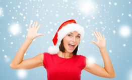 Mulher surpreendida no chapéu do ajudante de Santa Imagem de Stock Royalty Free