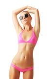 Mulher tan 'sexy' no biquini e nos óculos de sol Fotos de Stock