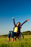 Mulher tida desvantagens na cadeira de rodas Imagem de Stock Royalty Free