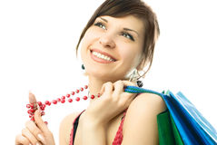 Mulher triguenha bonita com sacos de compra Foto de Stock