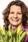 Mulher que aprecia flores imagens de stock royalty free