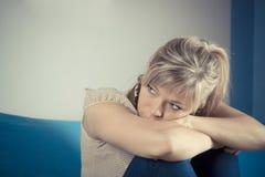 Mulher triste só profundamente nos pensamentos fotografia de stock royalty free