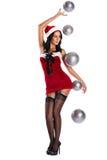 Mulher vestida como Santa Claus que guarda uma bola Foto de Stock Royalty Free