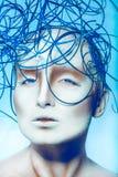 Mulher volutuoso com a decoração criativa na cabeça Imagens de Stock Royalty Free