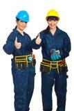 Mulheres bem sucedidas dos trabalhadores que dão os polegares Fotografia de Stock