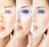 Mulheres com os hologras digitais do laser em seus olhos Fotografia de Stock