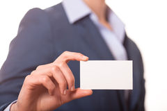 Mulheres de negócio que entregam um cartão Fotografia de Stock