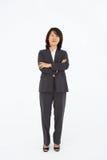 Mulheres de negócio que estão no terno de negócio Fotografia de Stock Royalty Free