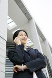 Mulheres de negócio que prendem o telefone fotografia de stock royalty free