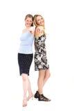 Mulheres de riso que apontam na câmera imagem de stock
