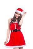 Mulheres de Santa com sacos A beleza Girl modelo asiático em Santa Hat isolou o Imagens de Stock Royalty Free