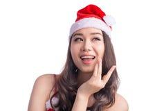 Mulheres de Santa com sacos A beleza Girl modelo asiático em Santa Hat isolou o Fotografia de Stock