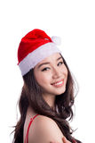 Mulheres de Santa com sacos A beleza Girl modelo asiático em Santa Hat isolou o Foto de Stock Royalty Free