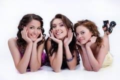 Mulheres de sorriso novas fotografia de stock