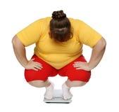 Mulheres do excesso de peso em escalas Fotos de Stock Royalty Free