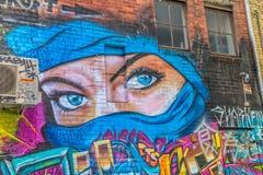 Mulheres dos olhos azuis dos grafittis de Melbourne Fotografia de Stock Royalty Free