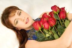 Mulheres e rosas fotos de stock