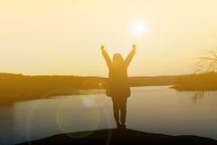 Mulheres felizes da silhueta no por do sol Foto de Stock Royalty Free