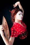 Mulheres japonesas que levantam com ventilador fotos de stock royalty free