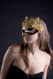 Mulheres na máscara dourada Foto de Stock Royalty Free