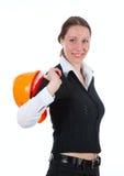 Mulheres novas dos bussines com o capacete sobre o branco Foto de Stock Royalty Free