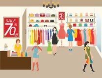 Mulheres que compram em uma loja de roupa Ilustração Stock