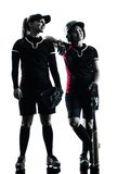Mulheres que jogam a silhueta dos jogadores de softball isolada Foto de Stock Royalty Free