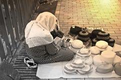 Mulheres que leem Qur'an Imagens de Stock