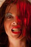 Mulheres que mostram seus dentes, leves com luz colorida Foto de Stock
