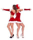 Mulheres 'sexy' de Santa que levantam como agentes secretos Foto de Stock Royalty Free