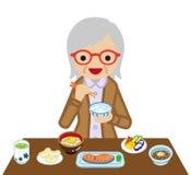 Mulheres superiores que comem o café da manhã do japonês ilustração royalty free