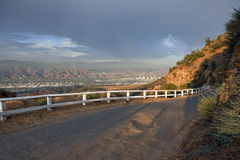 Mulholland Hwy. Famous Mulholland Hwy with thunder clouds and afternoon light.  High in the hills above Los Angeles Burbank and Glendale, California Royalty Free Stock Photo