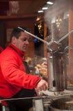Man serving churros at the christmas market Stock Photos