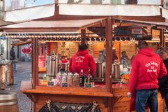 People at mulled wine stand at the christmas market Stock Image