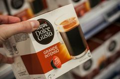Closeup of Nescafe expresso, the french brand of  coffee dose  in hand at Cora supermarket. Mulhouse - France - 3 January 2018 - closeup of Nescafe expresso, the Royalty Free Stock Photo