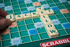 Plastic letters on Scrabble board game with words : Yellow Jacket. Mulhouse - France - 4 January 2019 - Closeup of plastic letters on Scrabble board game with stock photo