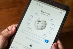 Wikipedia home page on tablet of the famous free encyclopedia site royalty free stock images