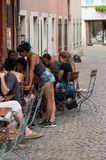 People at the bar terrace in cobblestone pedestrian street stock photography