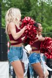 portrait of pompom girls dancing at Fun car show event royalty free stock photos