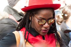 Portrait of black woman with red hat playing music in the street royalty free stock image