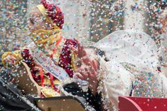 Portrait of children parading in the street throwing confetti stock photos