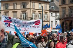 People from public service protesting with flags against the lower wages and new reforms from the government. Mulhouse - France - 9 May 2019 - people from public stock photo